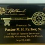 9 x 12 Gloss Black Plaque with a key to the city mounted on it!  Text color filled.